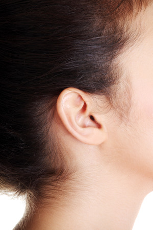 Young caucasian woman ear closeup.  photo