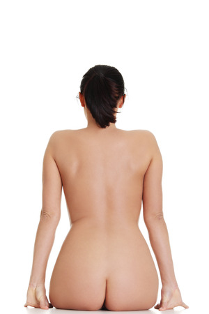 Beautiful naked woman sitting,rear view. Isolated on white. photo
