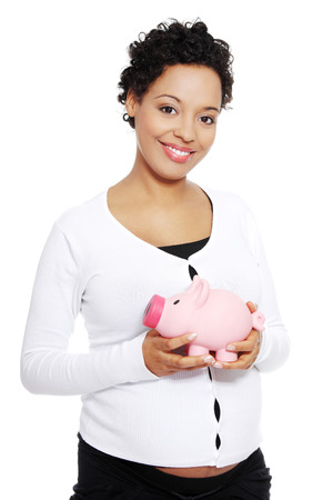 Pregnant woman holding piggy bank , isolated on white background  photo