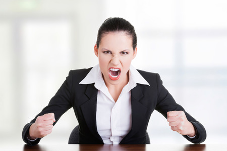 Stressed or angry businesswoman screaming loud  photo