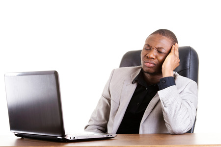 Stressed businessman working on laptop, isolated on white photo