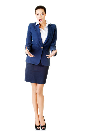 expresses: Young business woman expresses shock. Isolated on white.
