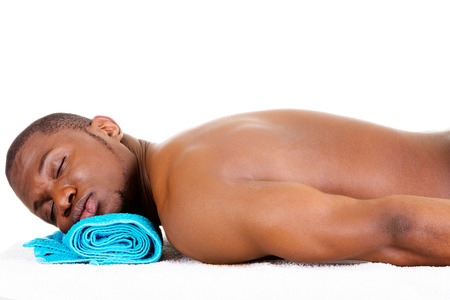 Man receiving massage at spa saloon photo