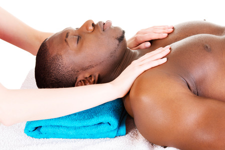 Man receiving massage at spa saloon photo