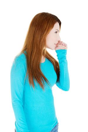 hesitations: Beautiful woman talking gossip , isolated on white