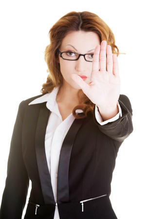 disclaim: Serious business woman gesturing stop sign, isolated on white  Stock Photo