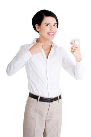 Businesswoman showing led bulb, isolated on white photo