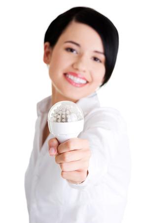 Businesswoman showing eco led bulb, isolated on white  photo