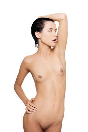 corps femme nue: Sensual belle jeune femme nue avec la peau propre et sain, isolé sur blanc