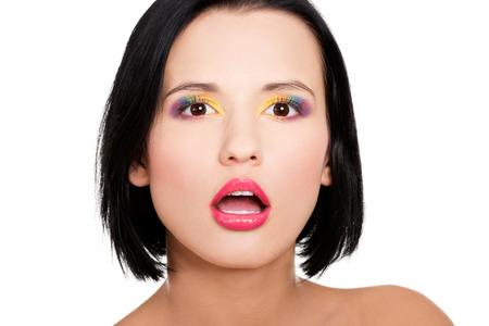 Beautiful woman with rainbow eye make up, isolated on white photo