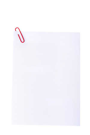White paper with office clip. Isolated on white. photo