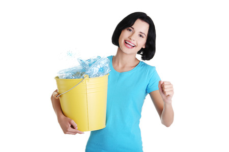 Beautiful young woman holding recycling bin isolated on white background.  photo