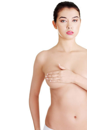 Breast cancer concept - Woman holding her breast  photo