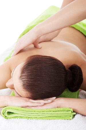 Woman relaxing in spa saloon - beeing massaged Stock Photo