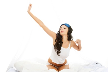Beautiful smiling woman stretching her body in the morning photo