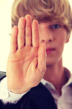 showed: Hold on, Stop gesture showed by businessman hand