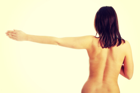 nude brunette: Nude beautiful female body from behind, with right arm up
