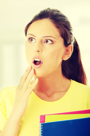 mouth opened: Shocked university student girl with mouth opened