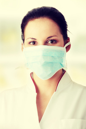ah1n1: Young nurse or doctor in mask Stock Photo