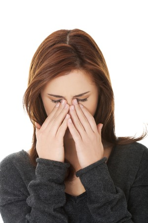 sore eye: Young woman with sinus pressure pain