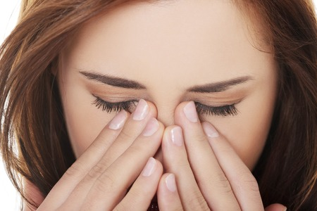 eyes: Young woman with sinus pressure pain