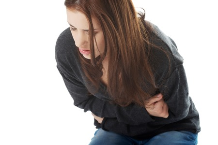 Young woman with stomach issues Stock Photo
