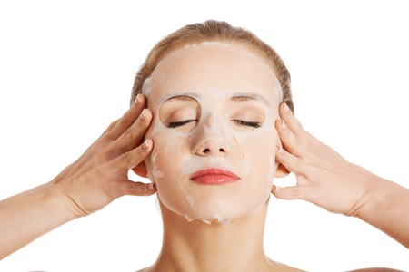placenta: Beautiful woman with collagen mask on face. Stock Photo