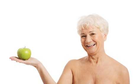 60 years old happy woman holding and apple photo