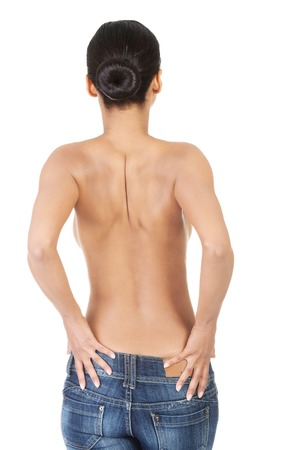 A young sexy woman is wearing blue jeans. Rear view.