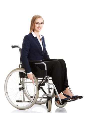Beautiful caucasain business woman sitting on wheelchair. Isolated on white. Stock Photo