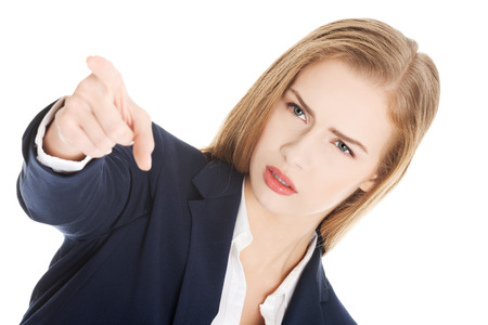disclaim: Beautiful business woman is showing warning sign. Over white. Stock Photo