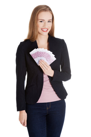 Beautiful business woman holdng euro currency money. Isolated on white. photo