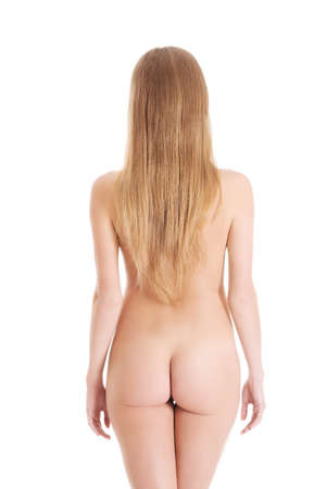 nude back: Beautiful naked womans back with supple buttocks.  Isolated on white.