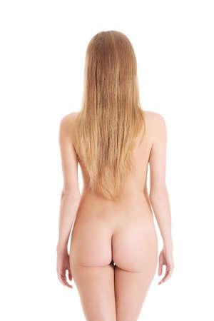 desnudo de mujer: Espalda de la mujer hermosa desnuda con las nalgas flexibles. Aislado en blanco.