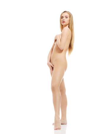 nude woman standing: Beautiful naked caucasian woman standing. Isolated on white. Stock Photo