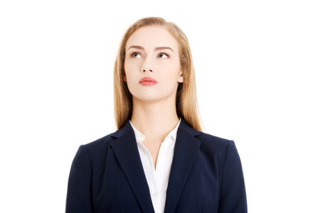 Beautiful business woman looking up at copy space. Isolated on white.