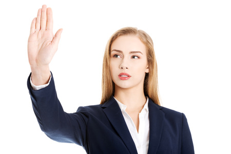 disclaim: Beautiful business woman is having had up showing stop gesture. Isolated on white. Stock Photo
