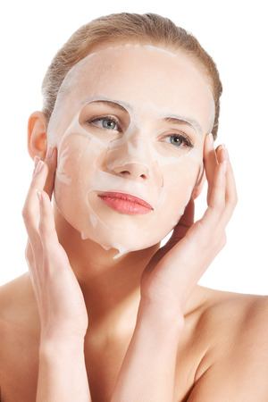 Beautiful young woman with collagen mask. Isolated on white. Stock Photo
