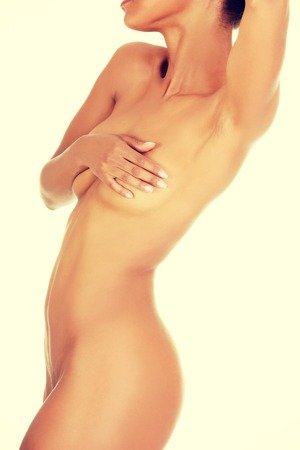 african american nude: Close up of perfect nude body of young fit woman