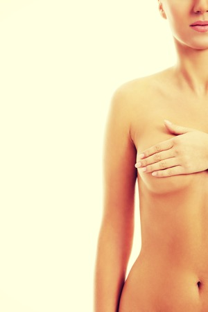 naked breast: Young topless woman is examinning her breasts Stock Photo