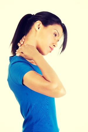 Young woman holding hand on her neck. Neck pain concept photo