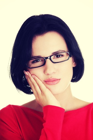 painfully: Young caucasian woman with toothache. Stock Photo