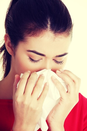 ah1n1: Teen woman with allergy or cold. Stock Photo