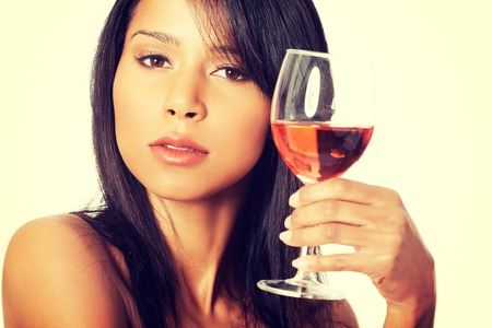 Portrait of young happy beautiful woman with glass of rose wine photo