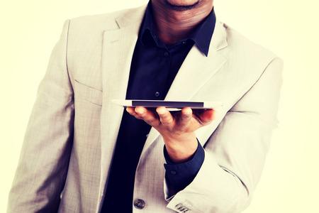 Handsome businessman working on tablet computer photo