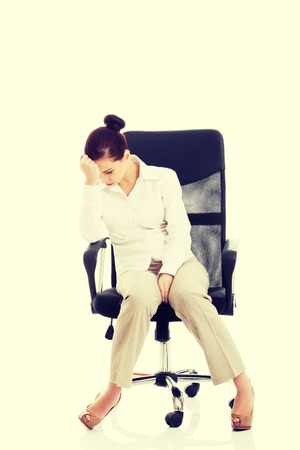 broken chair: Young beautiful business woman sitting on a chair and looking tired, broken.