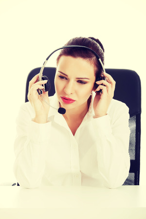 Beautiful woman sitting with microphone and headphones photo