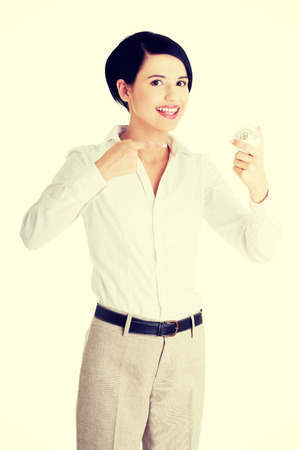 Business woman showing led bulb photo