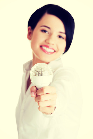 Businesswoman showing eco led bulb photo