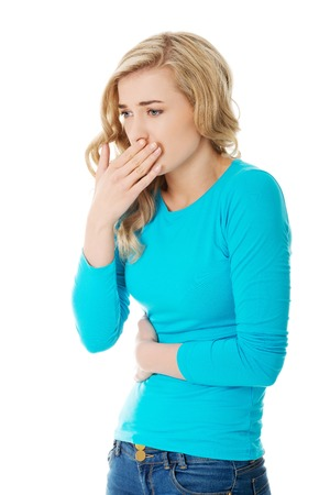 Sick woman about to throw up holding her stomach photo